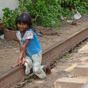 A girl sitting on the train tracks in Sri Lanka
