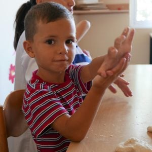 A boy engaging in sensory play at New Day Centre, Albania