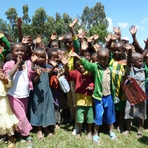Many Ethiopian children waving and smiling