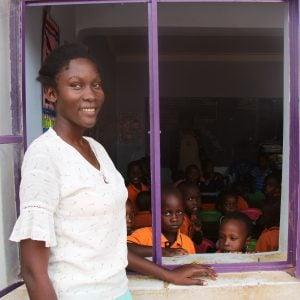 Reina as a teacher, outside her classroom