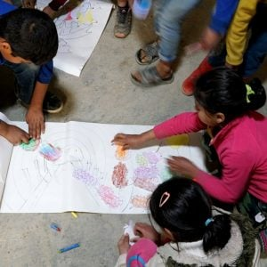 Syrian children colouring together