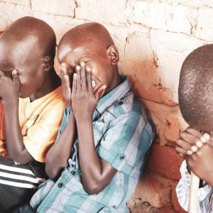 Ugandan children praying