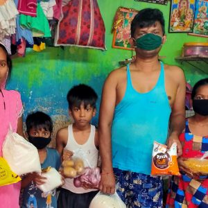 Patripul family in single room with food parcel