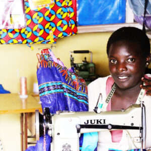 A seamstress trainee at her sewing machine