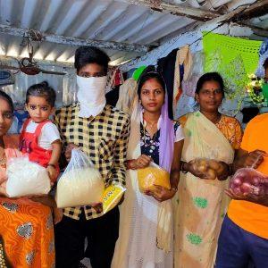 A Patripul family receiving a food parcel