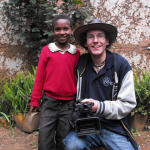 Rob with a smiling child in Ethiopia