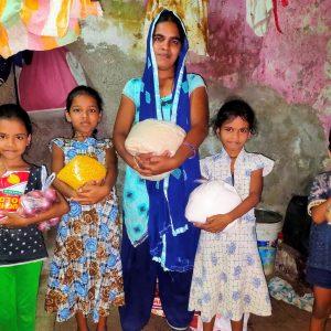 Vinod & Priya's family receiving their second food parcel