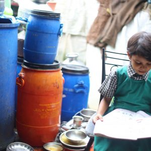 Dalit child studying in her home