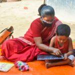 Teacher and child at Bangladesh preschool